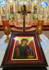Icon of St. Michael protecting our church as seen on the tetrapod, liturgical table in front of the ambon.
