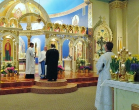 Altar Servers stand reverently during chanting of Gospel