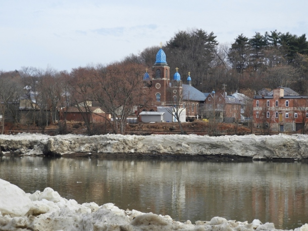 St. Michael the Archangel Byzantine Catholic Church in Pittston with ice cliffs along river bank.