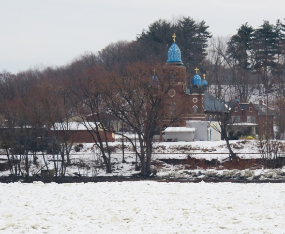 A frozen Susquehanna River contrasts with the blue domes of St. Michael the Archangel Byzantine Catholic Church, Pittston, Pennsylvania.
