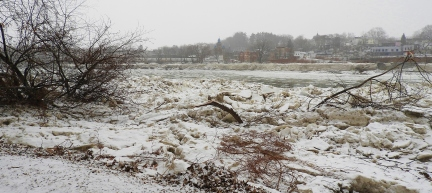 Powerful ice advancing down river collapsed full size trees on the river bank in West Pittston, Pennsylvania. St. Michael the Archangel Byzantine Catholic Church in distance as light snow begins to fall on Feb. 4, 2018.